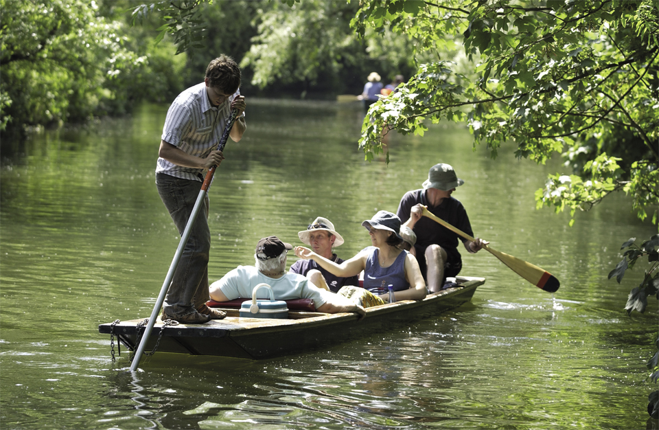 Self-hire punt goes up the river cam to grantchester from the company Scudamore's boatyards