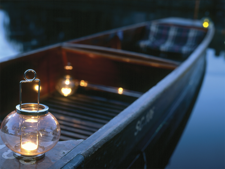 Punting at night on a candle lit boat